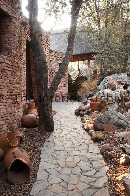 Rustic style stone accommodation, part of the Singita Pamushana Lodge, Malilongwe Trust, Zimbabwe.