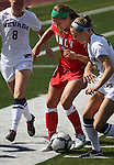 Jenn Wolfe, of the UNLV Rebels, plays against Lauren Braman of the Nevada women's soccer game in Reno, Nev., on Sunday, Sept. 3, 2011. UNLV won 2-1..Photo by Cathleen Allison