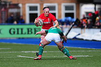 Mel Clay of Wales is tackled by Claire Molloy of Ireland during the Women's Six Nations match between Wales and Ireland at Cardiff Arms Park, Cardiff, Wales, UK. Sunday 17 March 2019