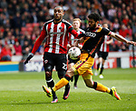 Leon Clarke of Sheffield Utd in action with Nat Knight Percival of Bradford City during the English League One match at Bramall Lane Stadium, Sheffield. Picture date: April 17th 2017. Pic credit should read: Simon Bellis/Sportimage