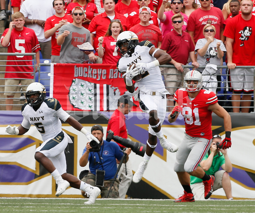 Navy Midshipmen safety Parrish Gaines (2) grabs a pass intended for Ohio State Buckeyes tight end Nick Vannett (81) for an interception during Saturday's NCAA Division I football game at M&T Bank Stadium in Baltimore on August 30, 2014. (Dispatch Photo by Barbara J. Perenic)