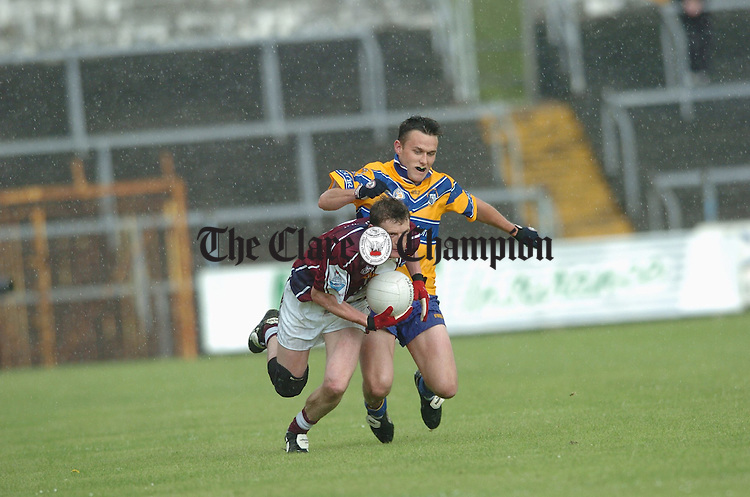 Westmeath's Colin Galigan is tackled by Clare's Peter O Dwyer. Photograph by John Kelly.