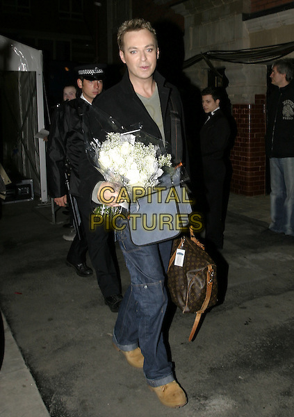 JULIAN CLAREY.Leaving the Royal Variety Performance, Coliseum, London,.December 14th 2004..full length Julien clary bunch of flowers bouquet.Ref: AH.www.capitalpictures.com.sales@capitalpictures.com.©Capital Pictures.