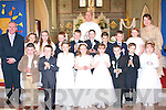 Pupils from Milltown NS who made their 1st Holy Communion with Fr Pat O'Donnell last Saturday in the Sacred Heart Church were front l-r: Patrick Clifford, Eugene McCarthy, JJ Flynn, Joan Nagle Hanafin, Grace O'Mahony, Joseph Hunt, Arturs Skadzius and Karolino Data. Back l-r: Liam Fell (principal), Lievta Kulevicute, Leah Clarke, Martin Foley, David Leane, Lynus O'Burke, Jason Dinham, CJ Cronin, Selena Morrissey and Mary Ellen O'Connor (teacher).