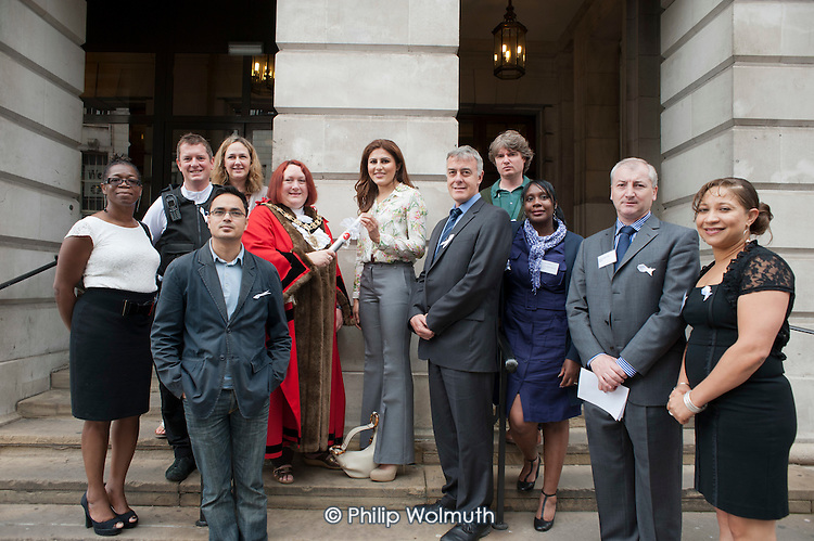 Handover from City of Westminster to Camden at a White Ribbon relay event organised by Hestia Housing & Support to raise awareness about violence against women and girls.  Camden Town Hall, London, 20/7/12.
