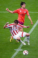 MELBOURNE, AUSTRALIA - NOVEMBER 14: Michael Marrone of the Heart is fouled during the round 14 A-League match between the Melbourne Heart and Brisbane Roar at AAMI Park on November 14, 2010 in Melbourne, Australia (Photo by Sydney Low / Asterisk Images)