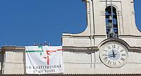 """Deputati del MoVimento 5 Stelle manifestano sul tetto della Camera dei Deputati contro la modifica dell'Articolo 138 della Costituzione, a Roma, 7 settembre 2013.<br /> Five Stars Movement's lawmakers protest to defend the Italian Constitution on the roof of the Lower Chamber in Rome, 7 September 2013. The banner reads """"The Constitution is of everybody""""<br /> UPDATE IMAGES PRESS/Isabella Bonotto"""