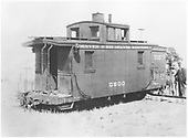 Caboose #0500 derailed on Rio Grande &amp; Southwestern during the scrapping of the Rio Grande &amp; Southwestern.<br /> D&amp;RGW - Rio Grande &amp; Southwestern    ca 1927