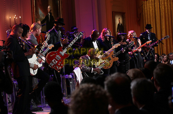 "Blues legend B.B. King performs with an all-star cast at a White House event titled In Performance at the White House: Red, White and Blues, February 21, 2012 in Washington, DC.  As part of the In Perfomance series, music legends and contemporary major artists have been invited to perform at  the White House for a celebration of Blues music and in recognition of Black History Month. The program featured performances by Troy ""Trombone Shorty"" Andrews, Jeff Beck, Gary Clark, Jr., Shemekia Copeland, Buddy Guy, Warren Haynes, Mick Jagger, Keb Mo, Susan Tedeschi and Derek Trucks, with Taraji P. Henson as the program host and Booker T. Jones as music director and band leader. .stage concert live gig performance performing music guitar full length.CAP/ADM/WM.©Win McNamee/Pool/CNP/AdMedia/Capital Pictures."