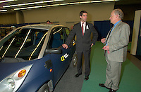 March 20 2003, Montreal, Quebec, Canada<br /> <br /> Andre Boisclair , Quebec Environment Minister (L) and Andre Caille, President and CEO, Hydro Quebec (Quebec Provincial provider of Electricity)(R) present it's Electric Car at Americana, a 3 days <br /> conference &amp; trade show on environement and waste management organized by Reseau Environnement, March 20 2003 in Montreal, Canada.<br /> <br /> Electric cars fits into Quebec and Canada's pledge to conform to Kyoto Protocol by reducing pollution.<br /> <br /> Mandatory Credit: Photo by Pierre Roussel- Images Distribution. (&copy;) Copyright 2003 by Pierre Roussel <br /> <br /> NOTE : <br />  Nikon D-1 jpeg opened with Qimage icc profile, saved in Adobe 1998 RGB<br /> .Uncompressed  Original  size  file availble on request.