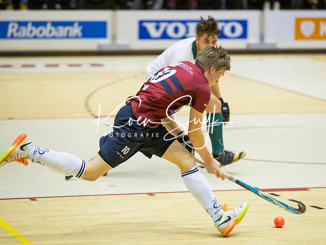 ROTTERDAM  - NK Nacompetitie Zaalhockey . Rotterdam HCKZ (3-3). Koen Beijen voor KZ aan de bal.     COPYRIGHT KOEN SUYK