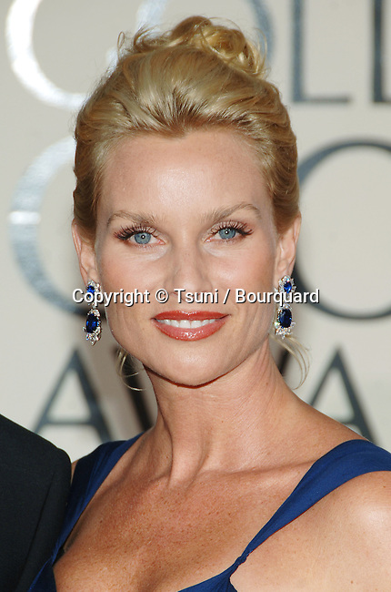 Nicolette Sheridan arriving at the Golden Globes Awards at the Beverly Hilton Hotel in Los Angeles. January 16, 2006.