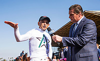 ARCADIA, CA - APRIL 07: Mike Smith talks to Eddie Olczyk to win the Santa Anita Derby at Santa Anita Park on April 07, 2018 in Arcadia, California.(Photo by Alex Evers/Eclipse Sportswire/Getty Images)