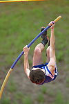 A pole vaulter on his way to the bar.