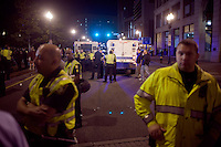 "Police stand near ""paddy wagons"" after forcibly removing OccupyBoston protesters at their second encampment at Rose F. Kennedy Greenway a block from Dewey Square, in downtown Boston, Massachusetts, USA.  The police and city officials warned protesters that they would be forceably removed from the site by midnight.  At about 1:30am police moved into the park, arrested approximately 100 protesters, and cleared the park of all tents and other protest materials.  The protesters are part of OccupyBoston, which is part of the OccupyWallStreet movement, expressing discontent with the socioeconomic situation of the 99% of the US population who are not wealthy.  Protestors have been camping in Dewey Square since Sept. 30, 2011. Gradually, larger organizations, including major labor unions, have expressed their support for the OccupyBoston effort."