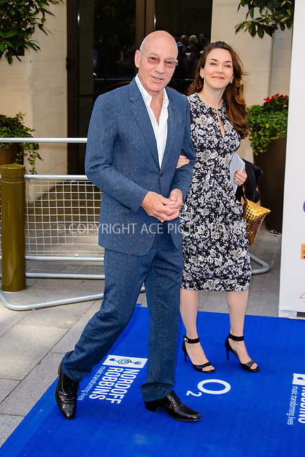 WWW.ACEPIXS.COM<br /> <br /> July 3 2015, London<br /> <br /> Patrick Stewart and Sunny Ozell arriving at the Nordoff Robbins O2 Silver Clef Awards at the Grosvenor House Hotel on July 3 2015 in London. <br /> <br /> By Line: Famous/ACE Pictures<br /> <br /> <br /> ACE Pictures, Inc.<br /> tel: 646 769 0430<br /> Email: info@acepixs.com<br /> www.acepixs.com