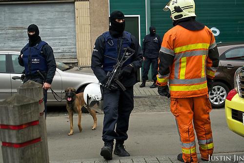 Police search in Brussels' Molenbeek neighbourhood for suspected Muslim terrorist Salah Abdeslam who was part of a group that killed 130 people in Paris.