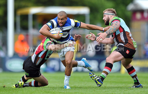 Jonathan Joseph takes on the Harlequins defence. Aviva Premiership match, between Harlequins and Bath Rugby on May 10, 2014 at the Twickenham Stoop in London, England. Photo by: Patrick Khachfe / Onside Images