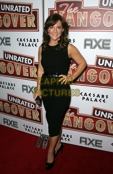 "RACHAEL HARRIS .Warner Home Video presents ""The Hangover"" DVD Launch Event at Pure Nightclub inside Caesar's Palace Resort Hotel and Casino, Las Vegas, Nevada, USA..December 10th, 2009.full length rachel black dress sleeveless hand on hip belt shoes clutch bag .CAP/ADM/MJT.© MJT/AdMedia/Capital Pictures."