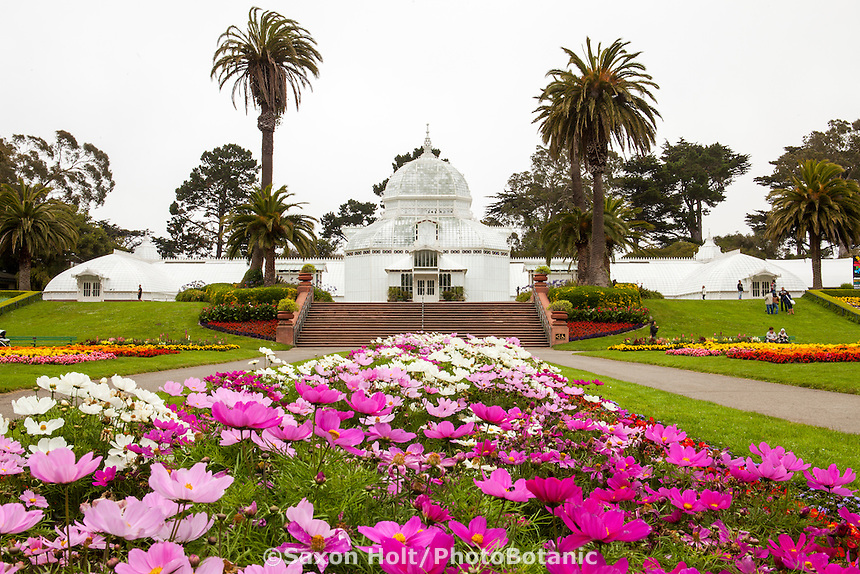 Front view of San Francisco Conservatory of Flowers in Golden Gate Park with flower beds