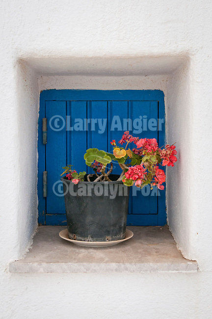 Window box, blue shutter, red geraniums, Folegandros, Cyclades, Greece