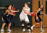 JANUARY 6, 2015 -- Logan Cowan #44 of Black Hills State protects the ball from South Dakota Mines defender Stacie Hull during their college women's basketball game Tuesday evening at the Donald E. Young Center in Spearfish, S.D. At right is Mackenzie Kenney #40 of South Dakota Mines.  (Photo by Dick Carlson/Inertia)