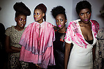 SOWETO, SOUTH AFRICA MAY 29: Models for the designer Avenue Floyd wait backstage before a fashion show at Soweto Fashion Week on May 29, 2014 at the Soweto Theatre in the Jabulani section of Soweto, South Africa. Local emerging designers showed their collections during the three-day event held at the theatre. Founded in 2012, Soweto fashion week gives a platform to local designers, models and artists. (Photo by: Per-Anders Pettersson)