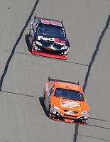 Sept. 28, 2008; Kansas City, KS, USA; Nascar Sprint Cup Series driver Tony Stewart leads teammate Denny Hamlin during the Camping World RV 400 at Kansas Speedway. Mandatory Credit: Mark J. Rebilas-