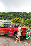 "FRENCH POLYNESIA, Raiatea. Karine, owner of the Raiatea Lodge picking up pineapples for the hotel from ""Mamie Fruits"" farm."