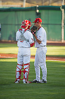 Orem Owlz catcher Tanner Lubach (8) has a meeting on the mound with pitcher Jared Ruxer (40) during the game against the Ogden Raptors in Pioneer League action at Home of the Owlz on June 20, 2015 in Provo, Utah.The Raptors defeated the Owlz 9-6.   (Stephen Smith/Four Seam Images)