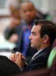 Nevada Assemblyman Derek Armstrong, R-Henderson, works in committee at the Legislative Building in Carson City, Nev., on Wednesday, Feb. 18, 2015. <br /> Photo by Cathleen Allison