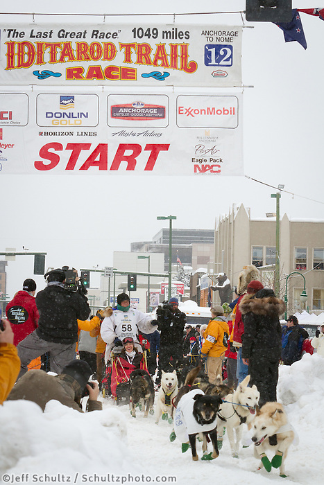 Gerald Sousa leaves the 2011 Iditarod ceremonial start line in downtown Anchorage, during the 2012 Iditarod..Jim R. Kohl/Iditarodphotos.com