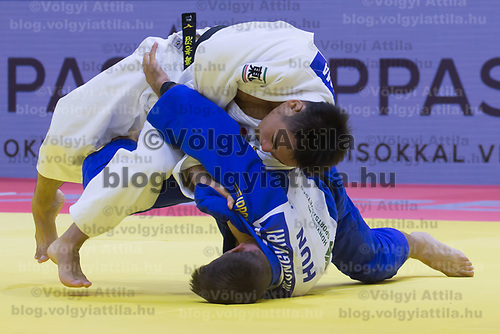 Miklos Ungvari (in blue) of Hungary and Masashi Ebinuma (in white) of Japan fight during the Men -73 kg category at the Judo Grand Prix Budapest 2018 international judo tournament held in Budapest, Hungary on Aug. 11, 2018. ATTILA VOLGYI