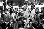 DURBAN, SOUTH AFRICA - APRIL 21: Nelson Mandela holds a child a crowd of ANC supporters April 21, 1994 in Durban, South Africa. The pre-election as he is surrounded by supporters and press at rally is just days before the historic democratic election on April 27, 1994 that Mr. Mandela won. Mr. Mandela became the first black democratic elected president in South Africa. He retired from office after one term in June 1999. (Photo by Per-Anders Pettersson)
