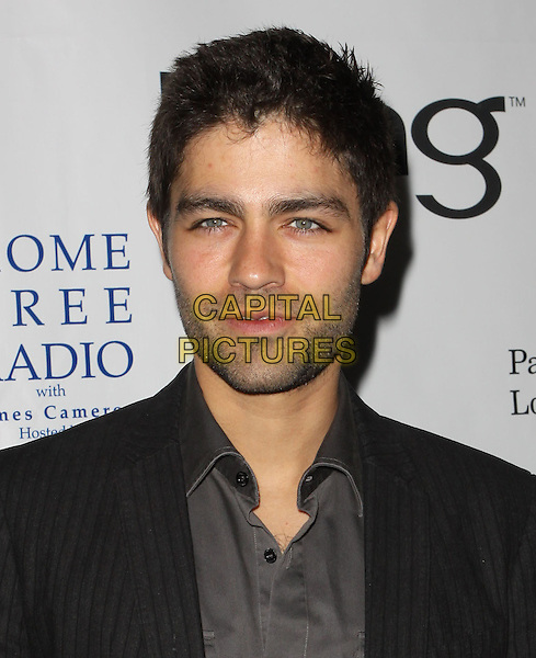 ADRIAN GRENIER .40th Annivesary of Earth Day held At The JW Marriott LA Live, Los Angeles, California, USA, 22nd April 2010..portrait headshot beard facial hair stubble grey gray shirt black .CAP/ADM/KB.©Kevan Brooks/AdMedia/Capital Pictures.