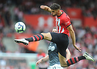 Southampton's Jack Stephens leaps for the ball<br /> <br /> Photographer Kevin Barnes/CameraSport<br /> <br /> The Premier League - Southampton v Burnley - Sunday August 12th 2018 - St Mary's Stadium - Southampton<br /> <br /> World Copyright &copy; 2018 CameraSport. All rights reserved. 43 Linden Ave. Countesthorpe. Leicester. England. LE8 5PG - Tel: +44 (0) 116 277 4147 - admin@camerasport.com - www.camerasport.com
