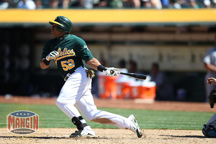 OAKLAND, CA - AUGUST 1:  Yoenis Cespedes #52 of the Oakland Athletics bats against the Tampa Bay Rays during the game at O.co Coliseum on Wednesday, August 1, 2012 in Oakland, California. Photo by Brad Mangin