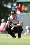 Bethesda, MD - June 29, 2014: Brendan Steele analyzes the break on the 14th hole putting green during Final Round of the Quicken Loans National at the Congressional Country Club in Bethesda, MD., June 29, 2014. (Photo by Elliott Brown/Media Images International)