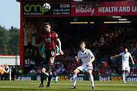 Lewis Cook of Bournemouth heads the ball away from Tom Carroll of Swansea City during the Premier League match between AFC Bournemouth and Swansea City at Vitality Stadium in Bournemouth, England, UK. Saturday 05 May 2018