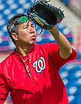 5 March 2015: Washington Nationals Medical Staff Assistant John Hsu helps out at batting practice prior to a Spring Training game against the New York Mets at Space Coast Stadium in Viera, Florida. The Nationals rallied to defeat the Mets 5-4 in Grapefruit League play. Mandatory Credit: Ed Wolfstein Photo *** RAW (NEF) Image File Available ***