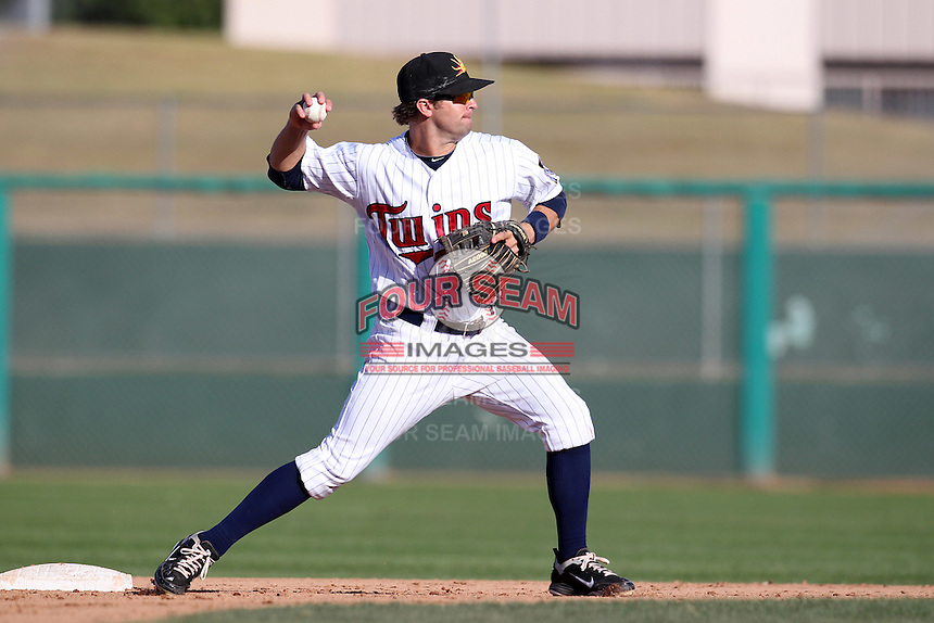 Mesa Solar Sox second baseman Brian Dozier #11 during an Arizona Fall League game against the Phoenix Desert Dogs at HoHoKam Park on November 3, 2011 in Mesa, Arizona.  Mesa defeated Phoenix 8-7.  (Mike Janes/Four Seam Images)