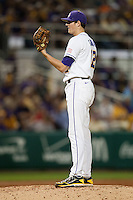 LSU Tigers starting pitcher Kevin Gausman #12 looks in for the catcher's sign against the Mississippi State Bulldogs during the NCAA baseball game on March 16, 2012 at Alex Box Stadium in Baton Rouge, Louisiana. LSU defeated Mississippi State 3-2 in 10 innings. (Andrew Woolley / Four Seam Images).