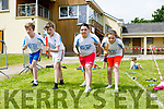 Enjoying the Fybough National School sports day at Keel GAA grounds on Thursday were Liam Evans, Shane Evans,  Jade Kelleher, Hannah Joy