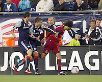 New England Revolution midfielder Chris Tierney (8) grabs at advancing Real Salt Lake forward Fabian Espindola (7). Real Salt Lake defeated the New England Revolution, 2-1, at Gillette Stadium on October 2, 2010.