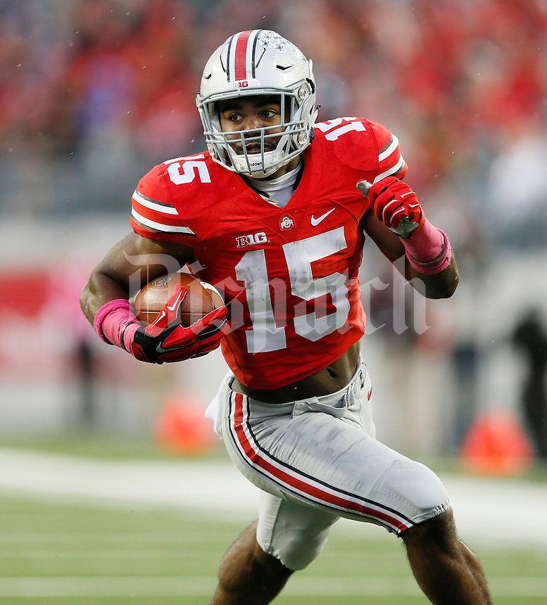 Ohio State Buckeyes running back Ezekiel Elliott (15) in action during an NCAA college football game between The Ohio State Buckeyes and the Rutgers Scarlet Knights at Ohio Stadium on Saturday, October 18, 2014.  (Columbus Dispatch photo by Fred Squillante)