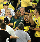 10/02/10-- Oregon quarterback Darron Thomas is surrounded by Duck fans after defeating  Stanford 52-31 at Autzen Stadium in Eugene, Or..Photo by Jaime Valdez....