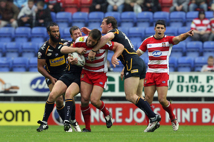 Photo: Richard Lane Photography..Wigan Warriors v Leeds Rhinos. Engage Super League 2007. 12/07/2007..Wigan's Bryan Fletcher (C) gets caught up in the Leeds pack.