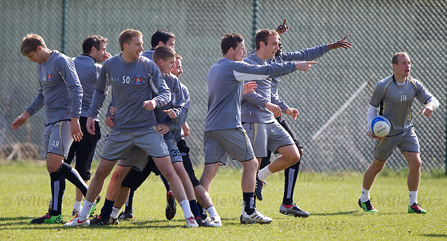 The Kilmarnock players laugh at the management team at training