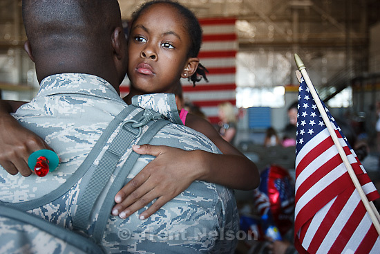 Trent Nelson  |  The Salt Lake Tribune.Tech Sergeant Robert Johnson holds his daughter Anaya after the 729th Air Control Squadron returned to Hill Air Force Base in Layton, Utah, after six months in Afghanistan Wednesday, July 20, 2011.