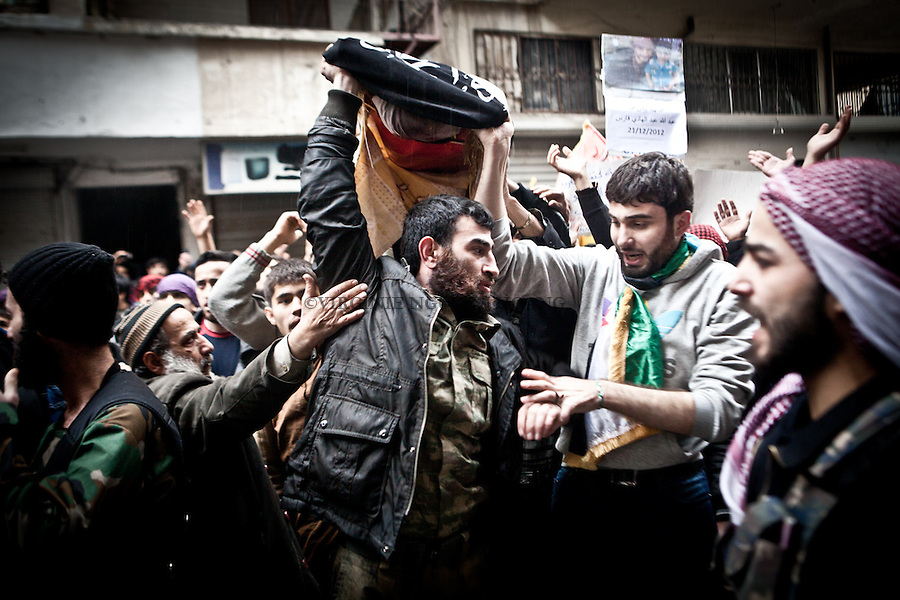 The body of a martyr is carried by members of his family during the friday protest in Bustan Al Kaser, Aleppo. .Le corps d'un martyr est transporté par les membres de sa famille pendant une manifestation a Bustan Al Kaser, Alep.